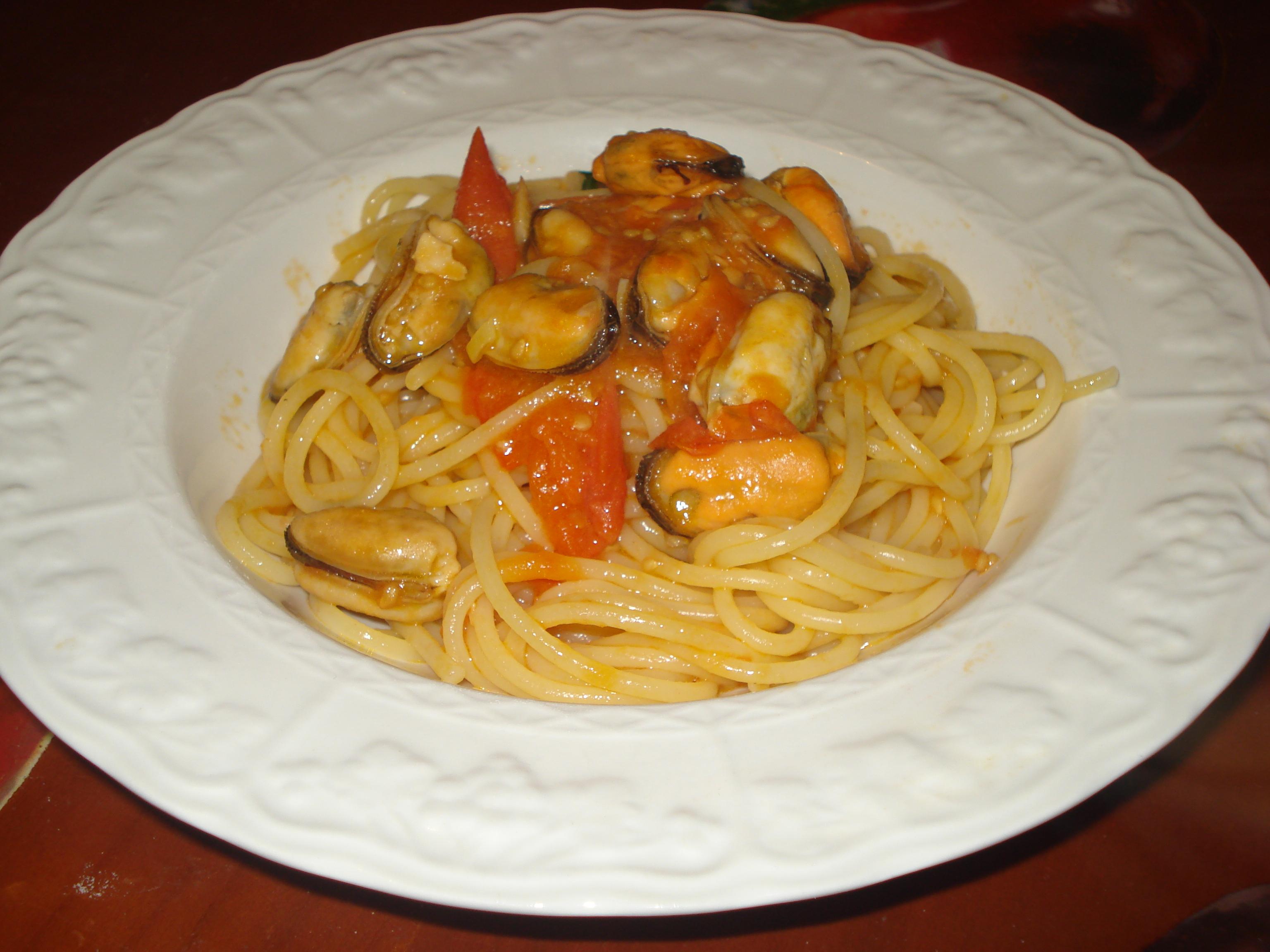 ricette come cucinare ie spaghetti con le cozze sgusciate e