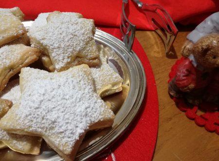 Biscotti a stella ripieni di nutella