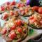 Melanzane gratinate al pesto con pomodorini e mozzarella