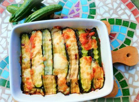 Parmigiana bianca di zucchine con prosciutto cotto e provola