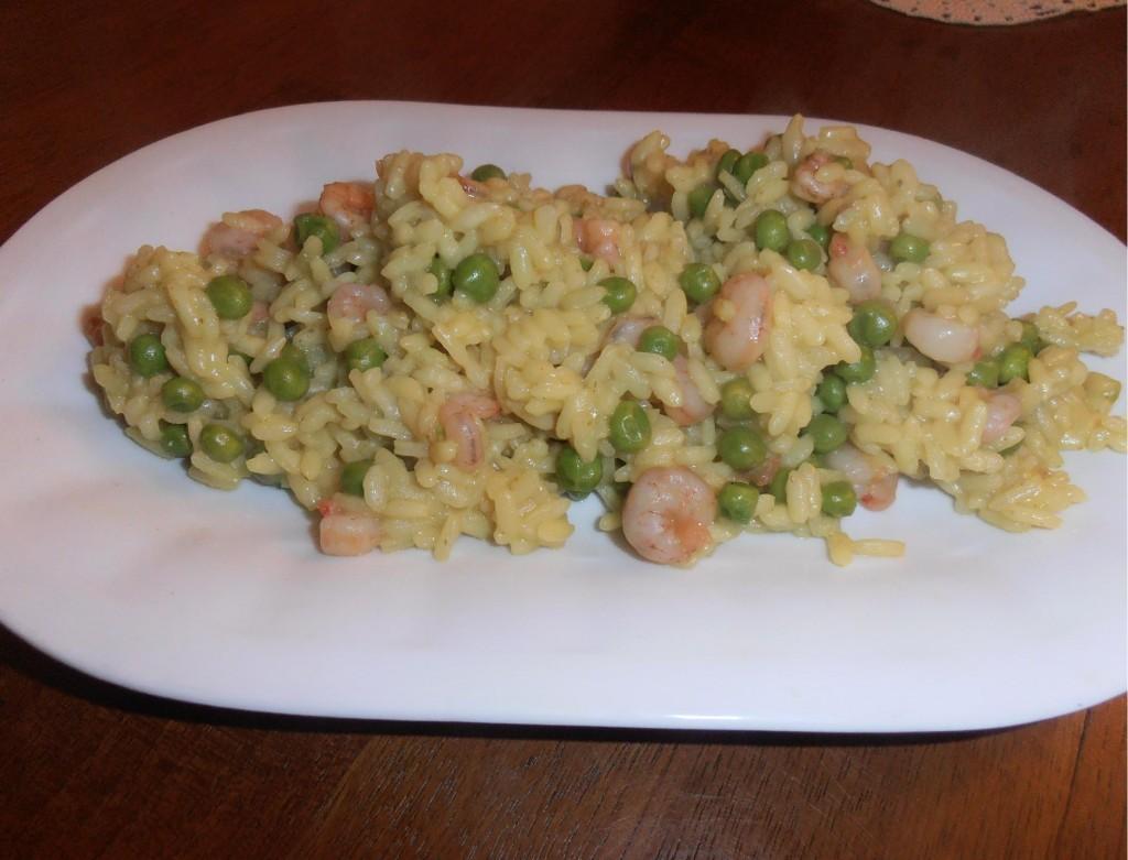 Riso al curry, piselli e gamberetti Ricetta