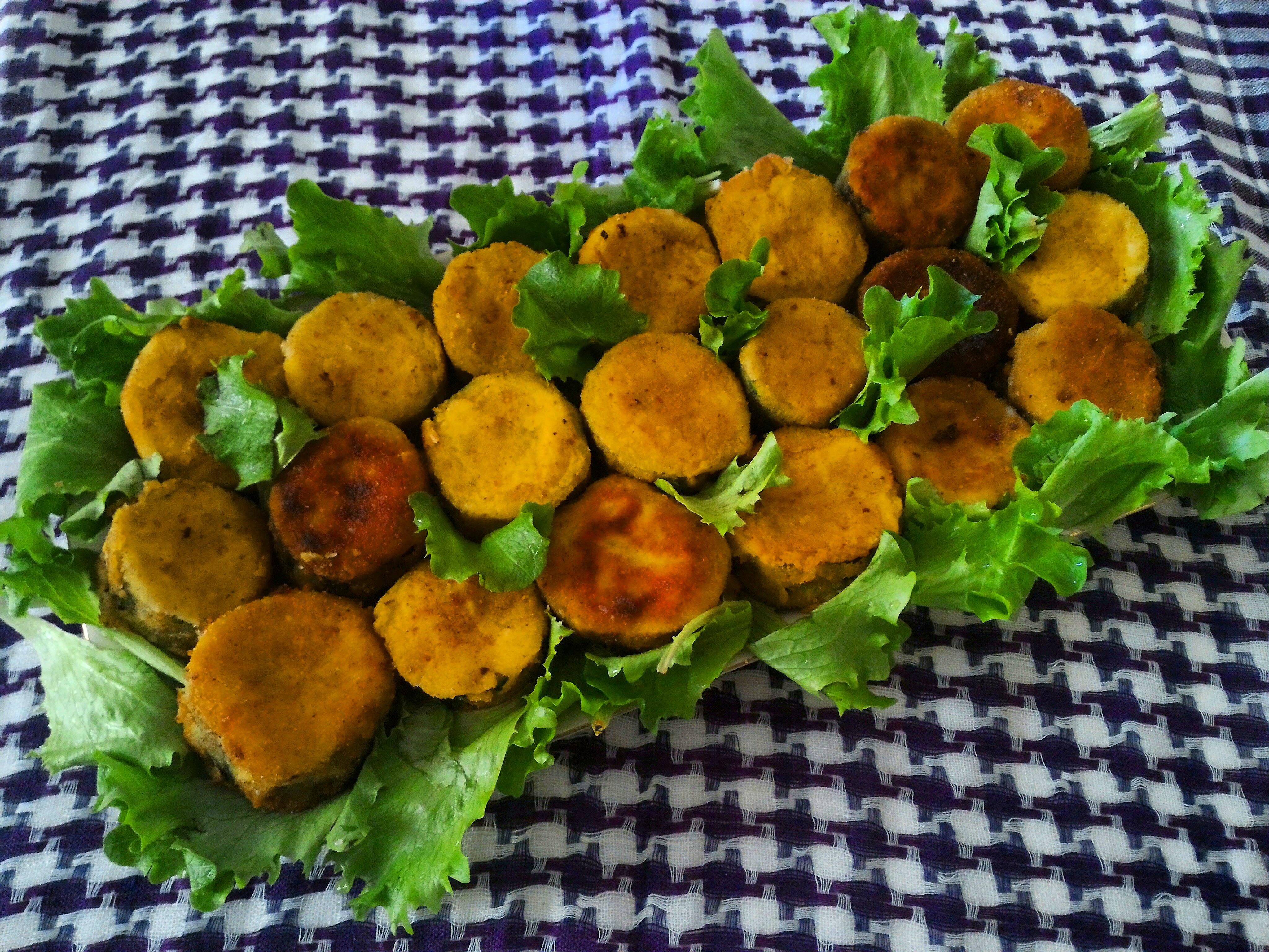 Medaglioni di zucchine soffritti con peperoni, philadelphia e sottilette al grana