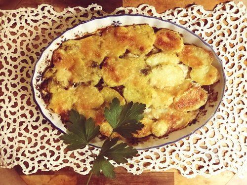 Parmigiana bianca con patate e alici