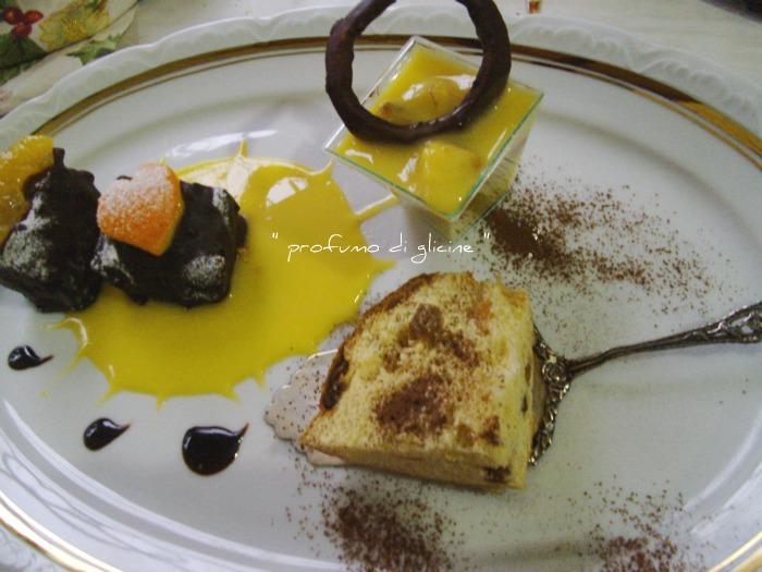 Cubotti di panettone al cioccolato fondente su salsa di arancia