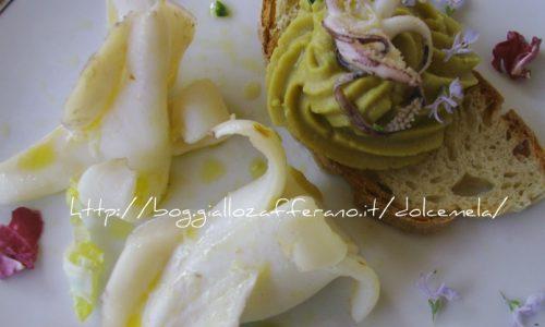 Calamari grigliati e crema di ceci su crostone di pane
