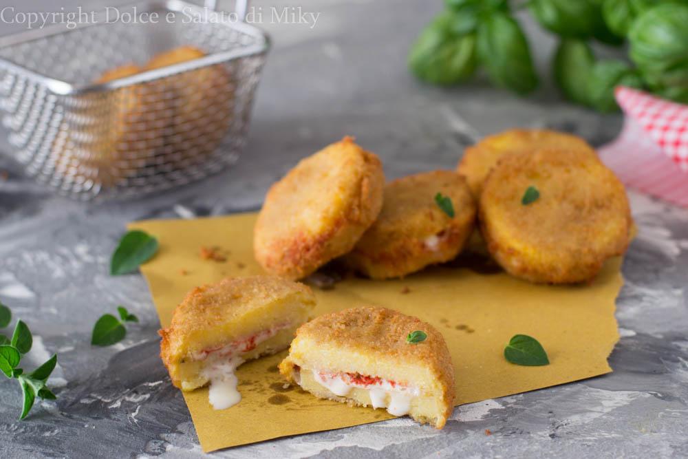 Medaglioni di polenta alla pizza
