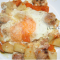 Uova fritte con salsiccia patate e zucca