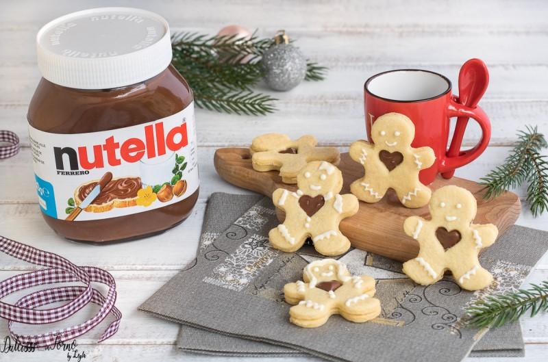 Biscotti Di Natale Tirolesi.Biscotti Natalizi A Forma Di Omino Con Cuore Di Nutella