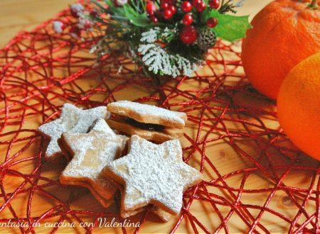 Biscotti stella con marmellata