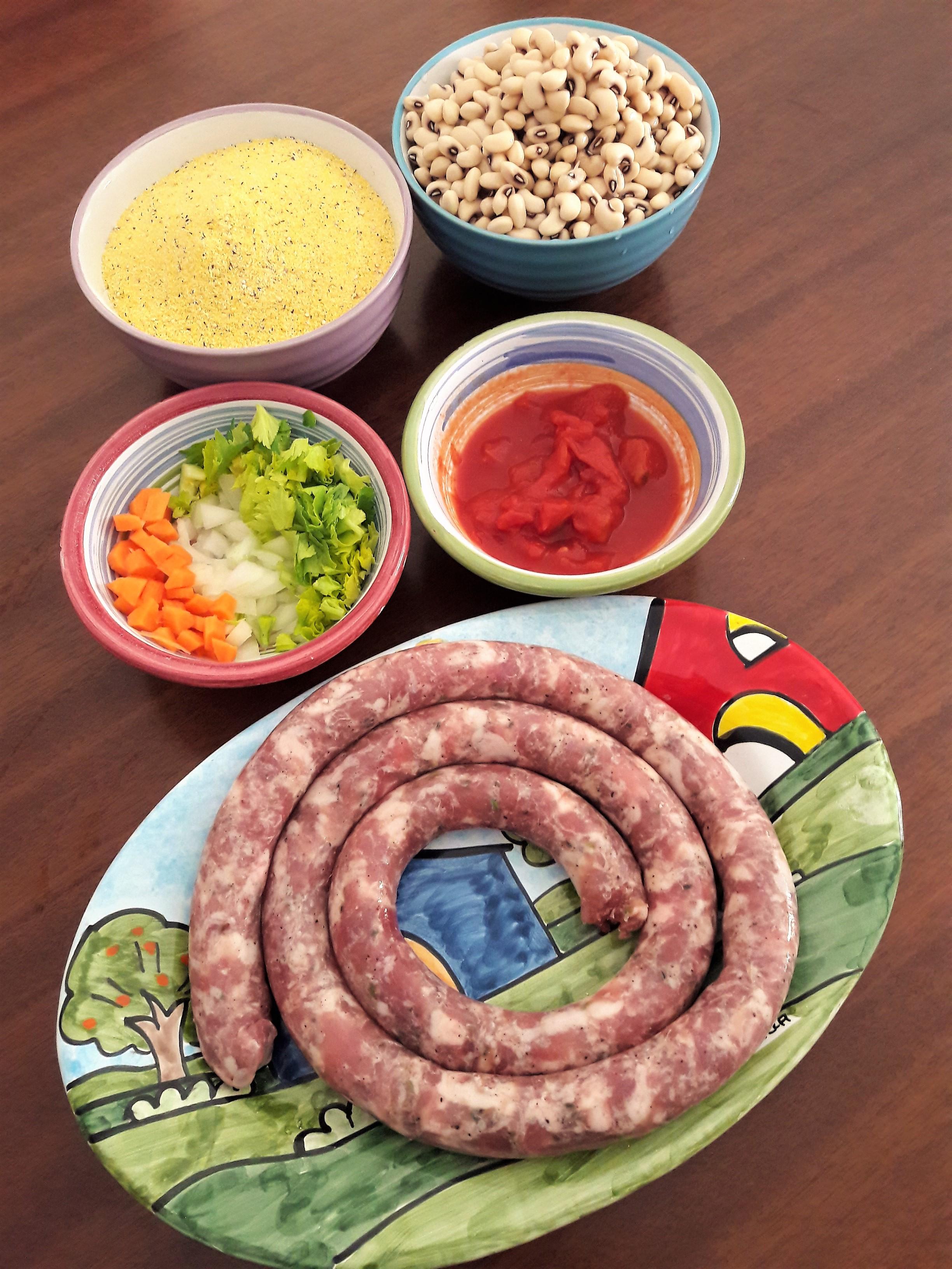 Polenta ai 5 cereali con salsiccia e fagioli Azuki.