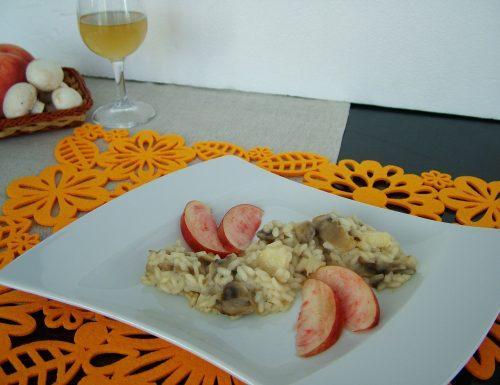 Risotto con champignon, pesche e prosecco