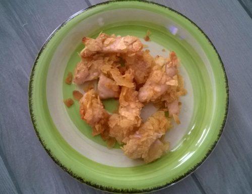 Straccetti di pollo impanati con patatine fritte