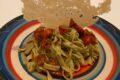 Fettuccine alle erbe aromatiche con pomodorini confit e chips di parmigiano