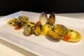 Ravioli di merluzzo e patate con sugo di vongole