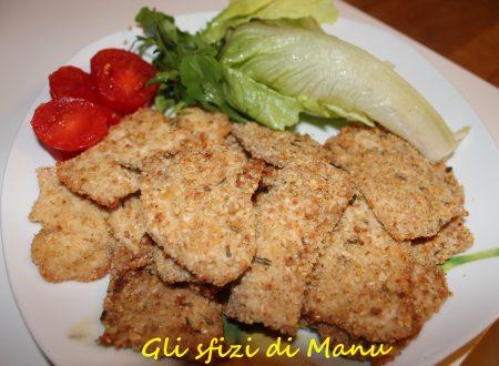Straccetti di pollo in panatura croccante al rosmarino e curry (al forno)