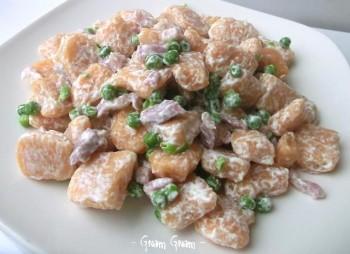 gnocchi di zucca panna piselli pancetta
