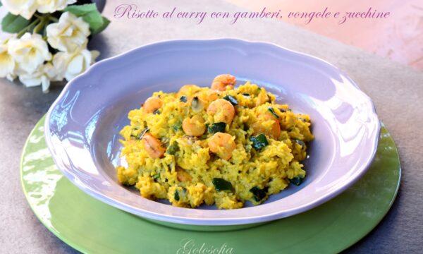 Risotto al curry con gamberi, vongole e zucchine, ricetta veloce e saporita