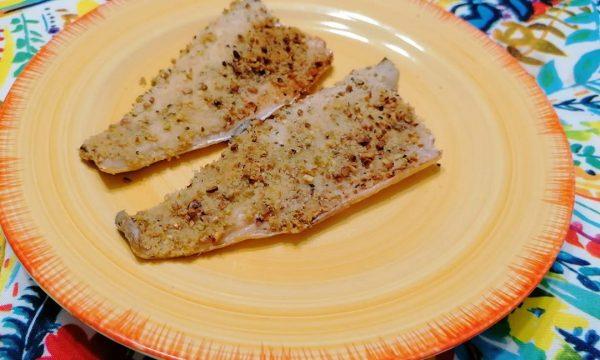 Filetti di branzino in crosta di pistacchi