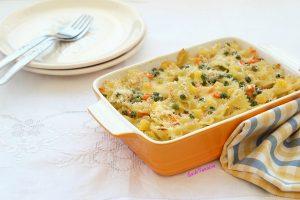 Pasta al forno con zucca e piselli