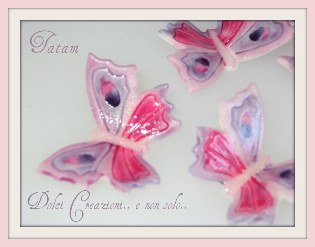 Farfalle in pasta di zucchero decorate a mano