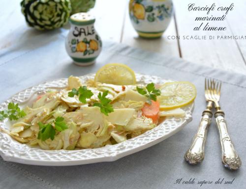 Carciofi crudi marinati al limone con scaglie di parmigiano