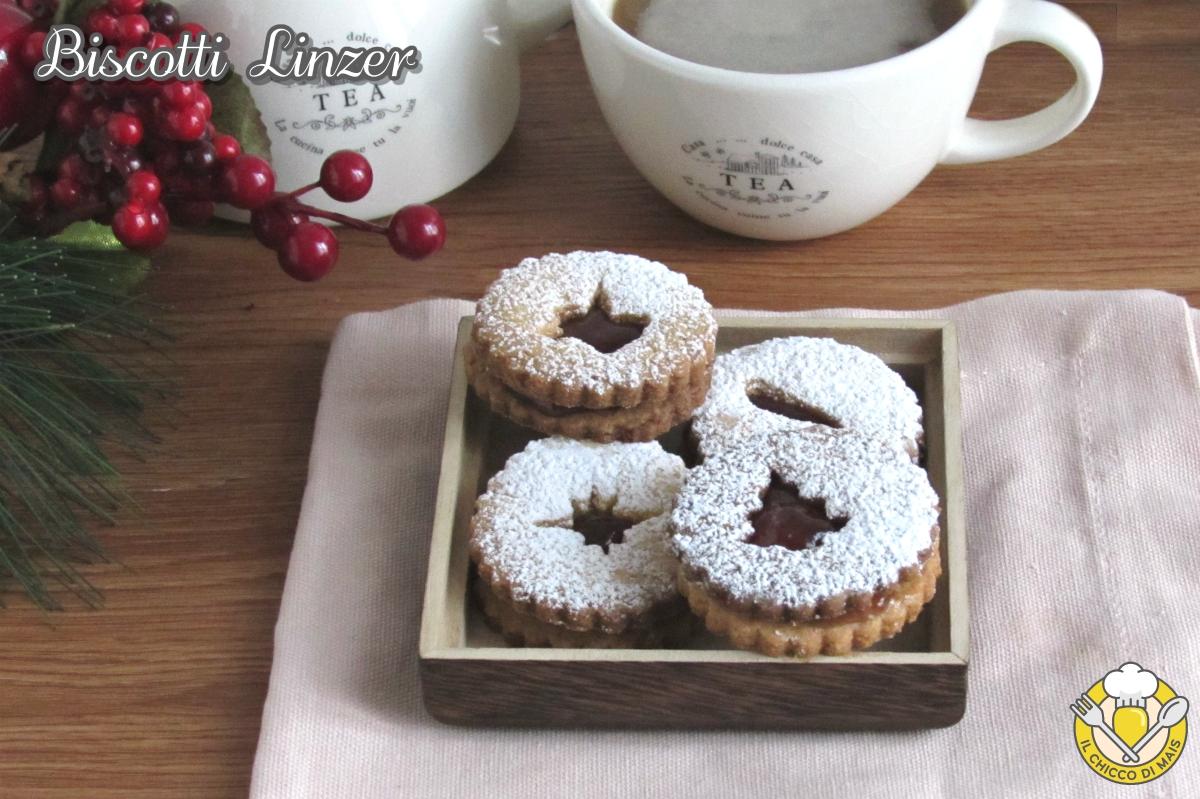 dolci di Natale biscotti linzer ricetta originale austriaca biscotti di natale farciti con marmellata il chicco di mais