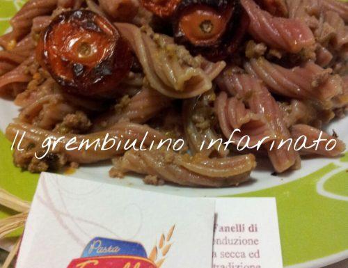 Fiaccole al vino rosso con ragu' bianco e pomodorini gratinati.
