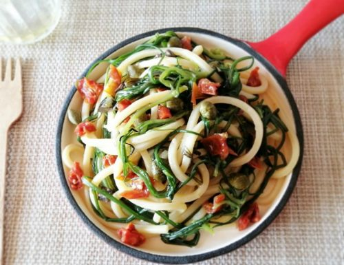 Spaghetti con agretti e pomodori secchi