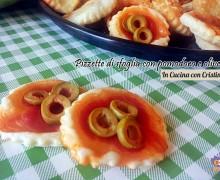 Ricette antipasti veloci: Pizzette di pasta sfoglia con pomodoro e olive