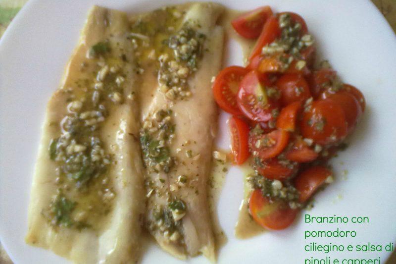 BRANZINO CON SALSA DI PINOLI E CAPPERI, ricetta di pesce