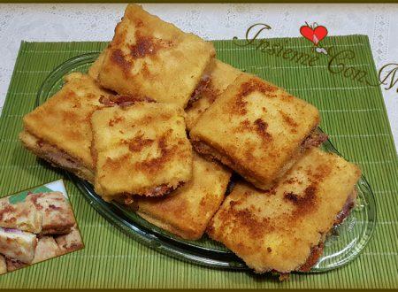 Quadrotti di polenta farciti con speck e formaggio filato