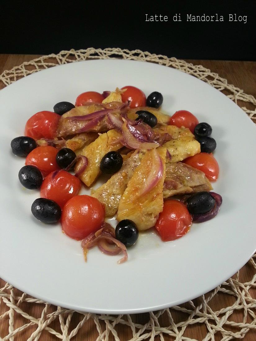 Tagliata di pollo con Pomodorini Cipolla e Olive