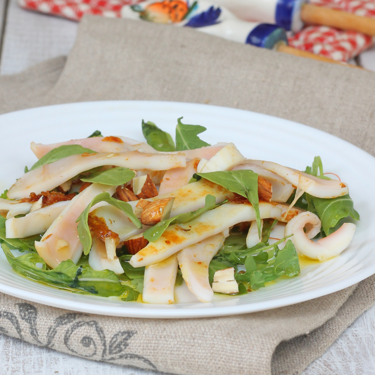 INSALATA DI TOTANI ricetta calamari in insalata di rucola e mandorle