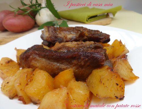 Costine di maiale con patate rosse