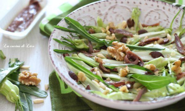 Insalata di puntarelle con acciughe, olive taggiasche e frutta secca