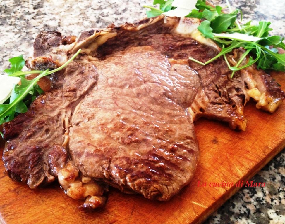 Tagliata di vitello con rucola e grana