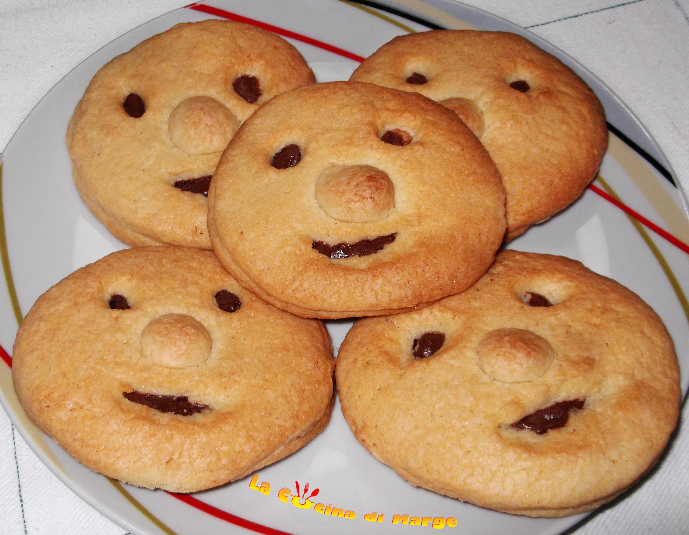 Faccine sorridenti di frolla con nutella ricetta biscotti for Foto ricette