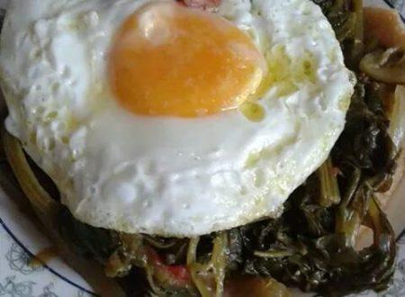 Broccoletti con prosciutto e uovo
