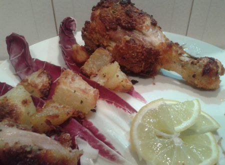 Cosce di pollo e patate al pane aromatico