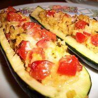 Zucchine ripiene con Parmigiano, riso e pomodoro