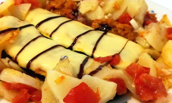 Zucchine ripiene di tonno e riso ai pomodorini