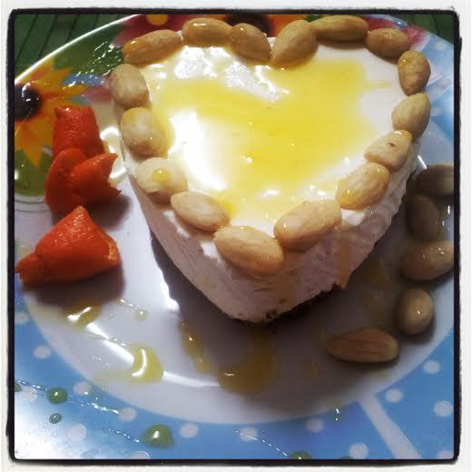 Cheesecake mandorle e salsa di mandarini