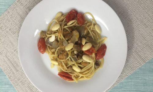 Spaghetti ai funghi e pomodori confit