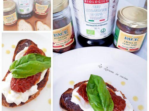 Bruschetta con crema di olive, burrata e pomodori secchi