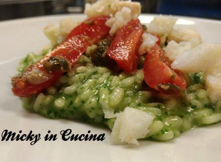 Risotto al basilico con baccalà, pomodorini e capperi