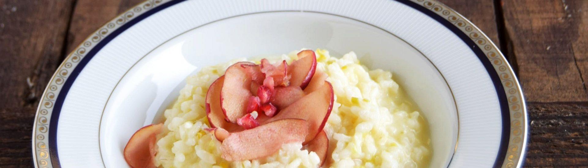Risotto porri e taleggio con mele marinate alla melagrana e miele