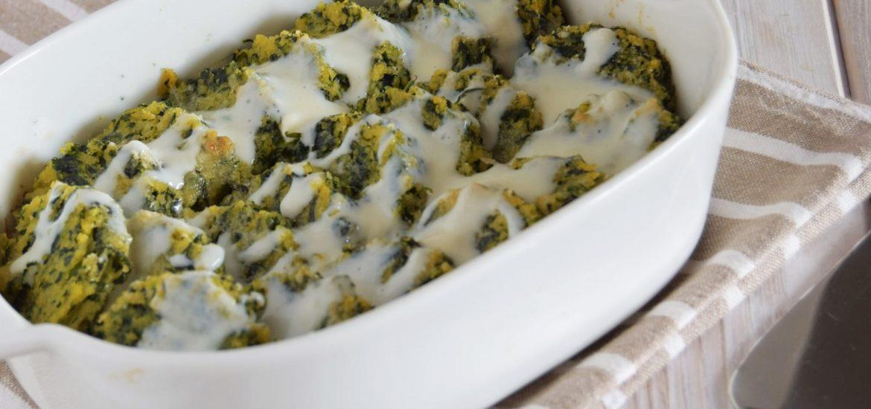 Medaglioni di polenta con spinaci e fonduta di taleggio