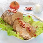 Arista di maiale alla melagrana con salsa demi-glace