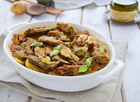 Teglia di carciofi e patate impanati con mozzarella al forno