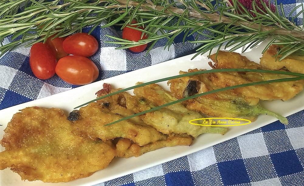 Fiori di zucca in pastella con mortadella,olive e mozzarella